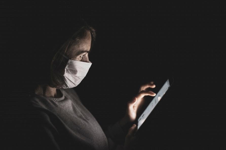 A person in a dark room Description automatically generated
